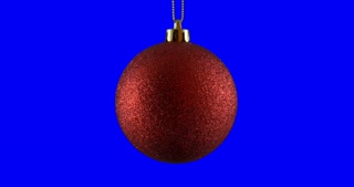 Red Christmas ball isolated on blue screen background, rotating loop