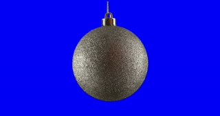 Silver Christmas ball isolated on blue screen background, rotating loop