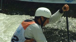 Two athletes participates in the ICF Wildwater Canoeing World Championships, 11 June 2014 on River Adda in Valtellina (Italy)