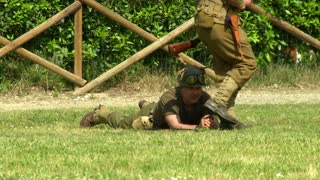 US soldiers on a battlefield during a WWII reenactment on 18 may 2014 in Signa, Italy