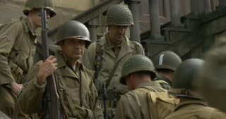US soldiers posing for a picture during a WWII reenactment on 20 September 2014 in San Quirico, Italy