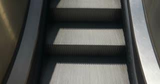 Escalator steps rising upward