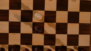 4K footage of a chess board from above, zoom in...