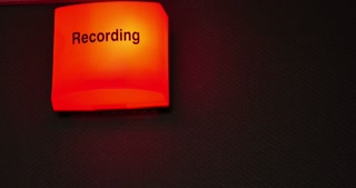 4K footage of a recording sign being turned on and off