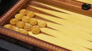 A backgammon game, the shot is moving slowly from left to right...