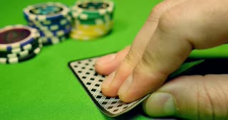 A black jack player takes his cards, bets, and reveals that he has got a black jack-HE TAKES ALL