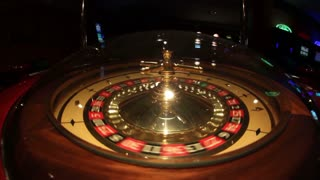 A casino roulette - the spinning ball stops at black 15...
