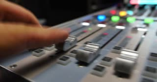 A fast audio adjustement on an audio mixer in a recording studio...