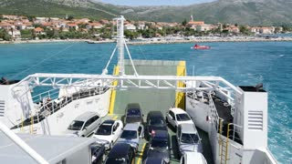 A ferry boat leaving the dock in Orebic, Croatia, and heading to Korcula