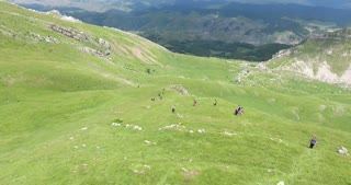 A group of hikers walking down the mountain