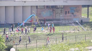 A lot of kindergarten children playing on the playground