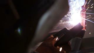 A man welding a metal construction - close up shot...