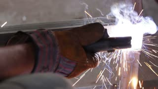 A man welding a metal construction...