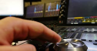 A man working on an audio mixer...