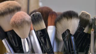 A moving shot of a bunch of make-up brushes...