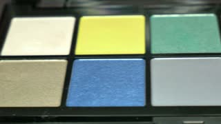 A moving shot showing a professional make-up palette...