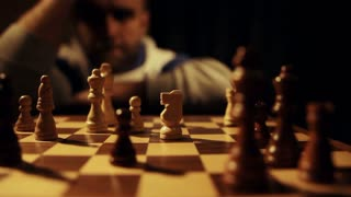 A nervous chess player watching the game and decides to make a move...