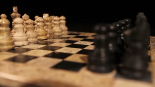 A person is starting a new chess game with his first move with a pawn...