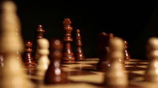 A person surrenders the game by putting his king in front of the black king...