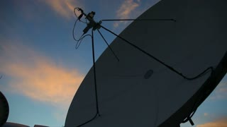 A satellite antenna at sunset searching for a channel...