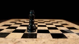 A white chess figure king overthrows a black king from the chess board and takes his place...
