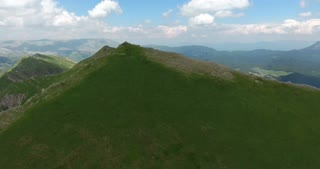 Aerial footage of a group of hikers resting on the top of a mountain...