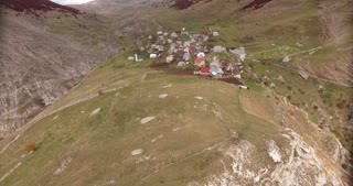 Aerial footage of an ethno village high in the mountains, the shot is rising...
