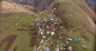 Aerial footage of an ethno village high in the mountains...