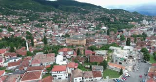 Aerial footage of Sarajevo and its national library...