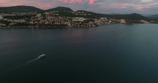 Aerial footage of the city of Neum in Bosnia-Herzegovina, with a boat floating on the sea...