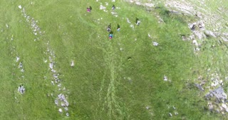 Aerial shot of a group of hikers enjoying in the mountains...