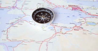 An unsteady compass lying on a road map, Istanbul is in sight with the west part of Turkey...