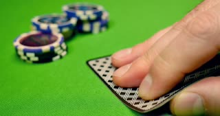 Black jack players betting on their cards, one player has got a black jack and takes all the chips