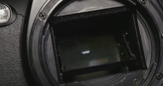 Checking the shutter on a photo camera...