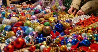 Christmas market-a lot of colorful Christmas tree balls on a table