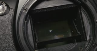 Cleaning an old cameras shutter, at the repair store...
