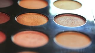 Close up footage of a make up palette, the shot is moving from one side to the other...