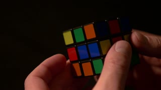 Close up footage of a man solving a Rubik´s cube...