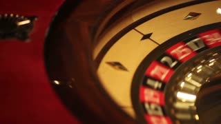 Close-up footage of a casino roulette - the shot moves from left to right...
