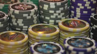 Close up footage of Las Vegas casino chips, the shot is going out of focus and comes again into focus...