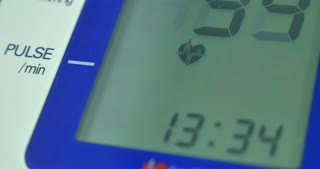 Close up footage of measuring heartrate and blood pressure on an electric device...