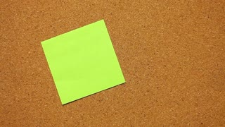 Close-up of a human hand that writes ˝I hate you!˝ on a post-it paper...
