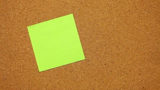 Close-up of a human hand that writes ˝I love you!˝ on a post-it paper...