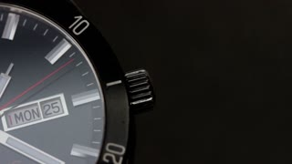 Close up shot of a black watch ticking...