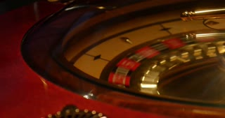 Close up shot of a casino roulette in motion-the shot moves from the left side to the right