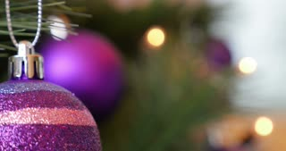 Close up shot of a Christmas tree and some decorations on it...
