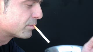 Close-up shot of a man smoking a cigarette