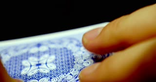 Close up shot of a person revealing his cards, he has got four aces
