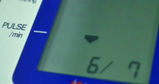 Close up shot of a pulsemeter, the pulse is 79, the heart-rate seems good