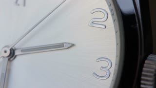 Close up shot of a white clock and its seconds hand...